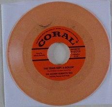 "7"" Johnny Burnette Trio : Train Kept A Rollin / Honey Hush."